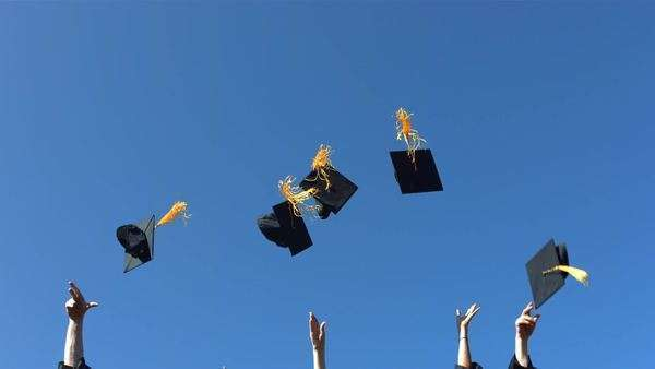 Tossing graduation caps, slow motion Royalty-free stock video