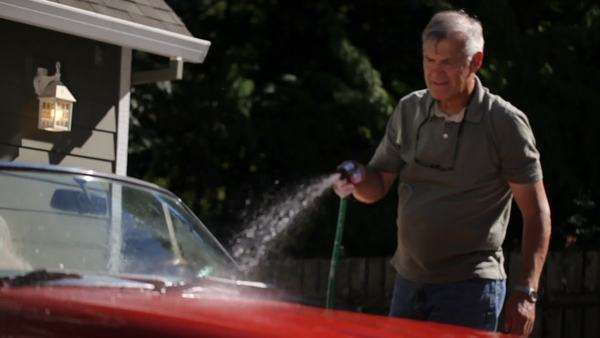 Grandfather and young boy washing car together Royalty-free stock video