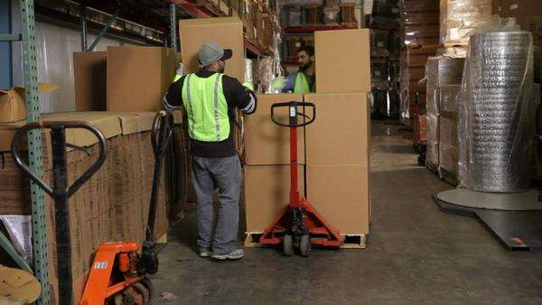 Delivery man moving packages in warehouse Royalty-free stock video