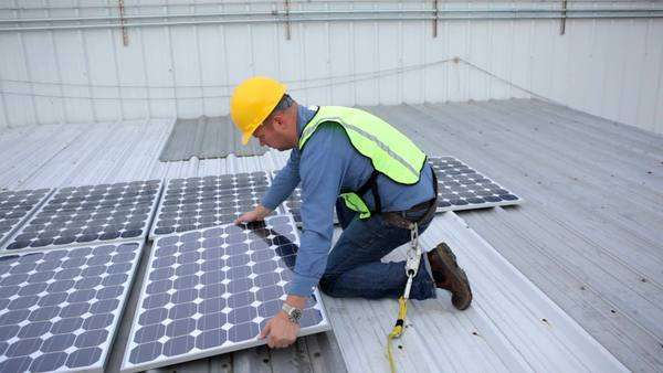 Contractor installing solar panels on rooftop Royalty-free stock video