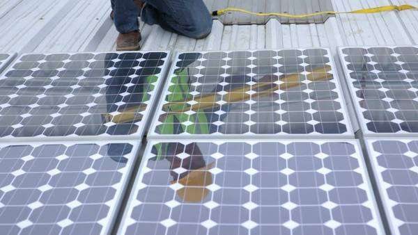 Contractor installing solar panels on industrial rooftop, portrait Royalty-free stock video