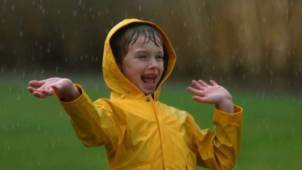 Young boy playing in rain, slow motion Royalty-free stock video