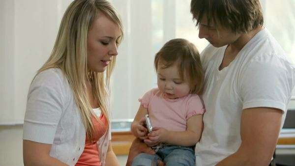 Family with young child talking on cell phone together Royalty-free stock video
