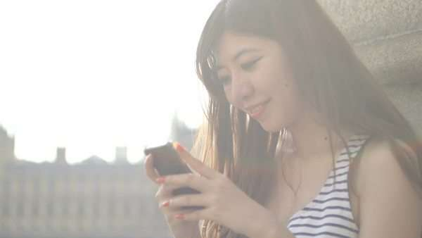 Young woman text messaging with Big Ben in background Royalty-free stock video