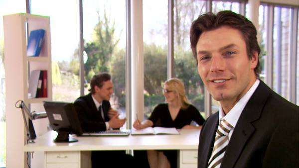 Portrait of attractive businessman in a light and modern office Royalty-free stock video