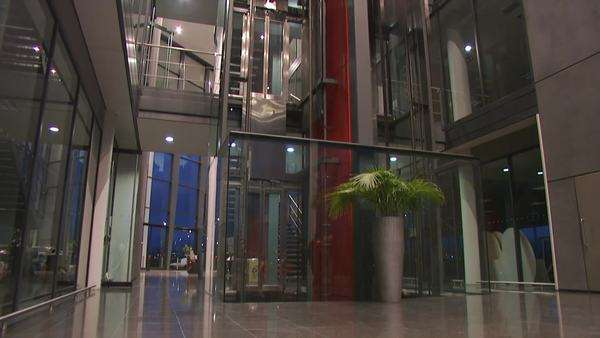 Timelapse office elevators and working staff in large modern building Royalty-free stock video