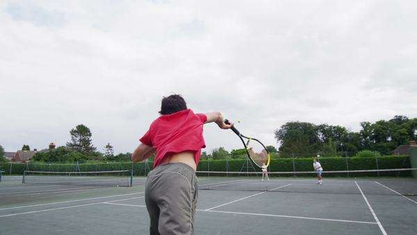 Tennis serve in slow motion from behind player Royalty-free stock video