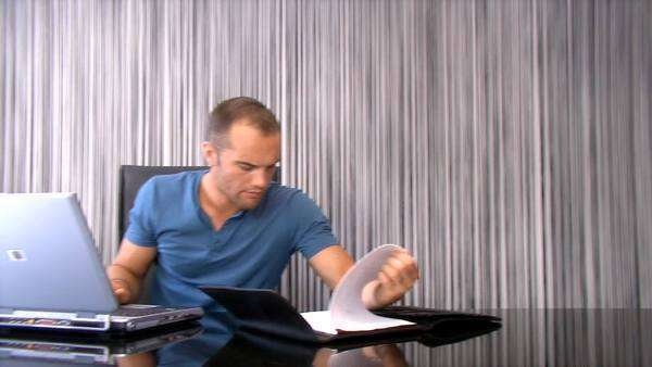 Attractive young man working on laptop at home Royalty-free stock video