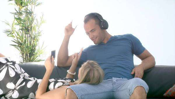Attractive young couple listening to music at home Royalty-free stock video