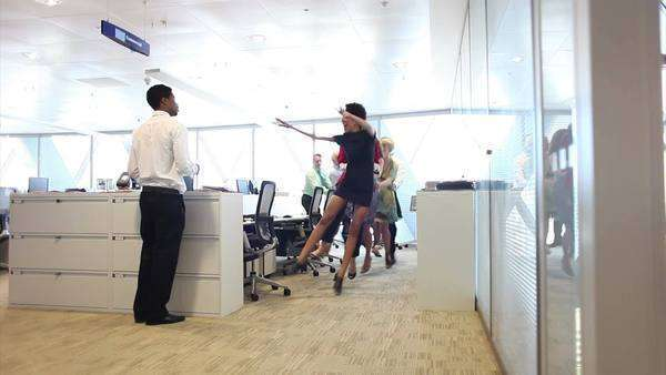 Funny group of business people dancing in large corporate offices Royalty-free stock video
