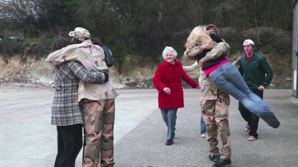 Army soldier returning home to the embrace of his family Royalty-free stock video