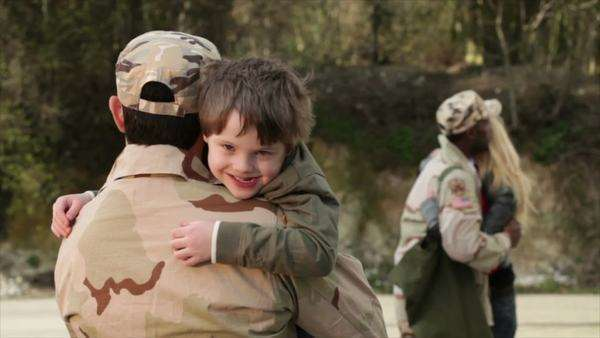 Army soldiers returning home to the embrace of family Royalty-free stock video