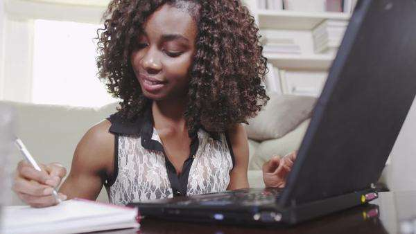 Young woman studying with laptop Royalty-free stock video