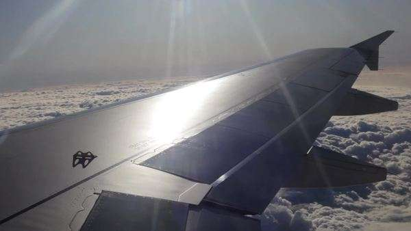 View of the wing of an airplane and the sky outside Royalty-free stock video
