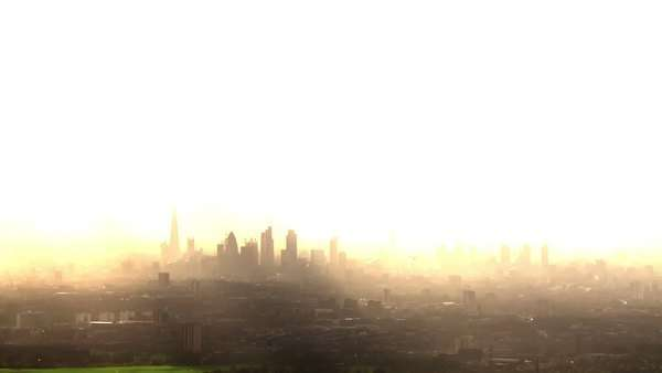 Aerial view of the London skyline on a hazy autumn morning. Royalty-free stock video