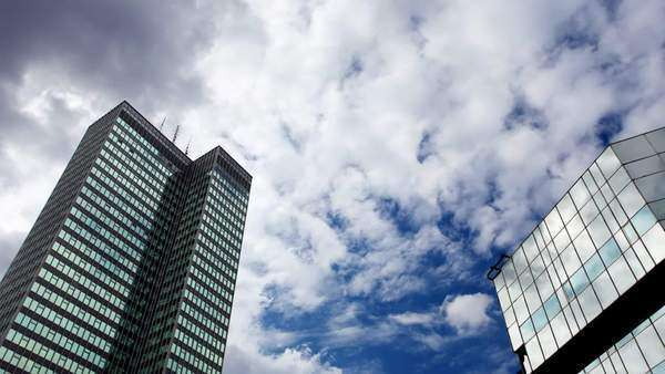 Reflections of clouds moving in glass mirrored office tower Royalty-free stock video