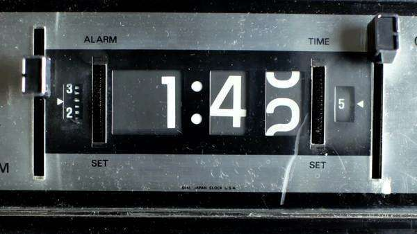 stop motion of an old style flip clock, running through 12 s Royalty-free stock video