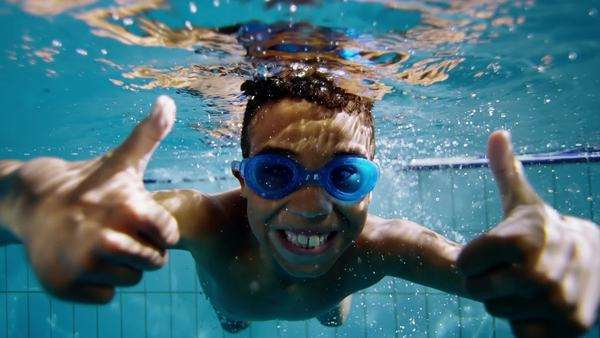 Happy cute little boy underwater gives a thumbs up to the camera. Royalty-free stock video