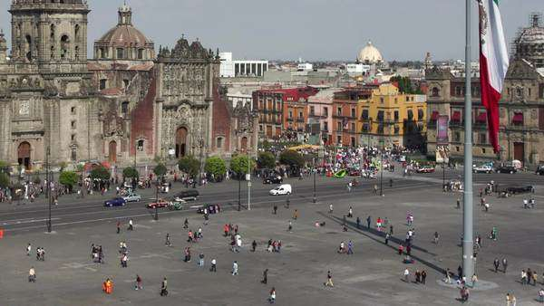 timelapse of the zocalo in Mexico city, with the cathedral and giant flag in the centre Royalty-free stock video
