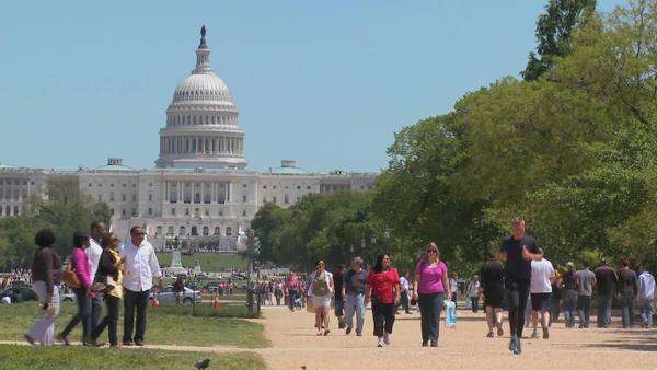 Tourists enjoy the summer weather in Washington DC with the Capitol Dome in the background. Royalty-free stock video