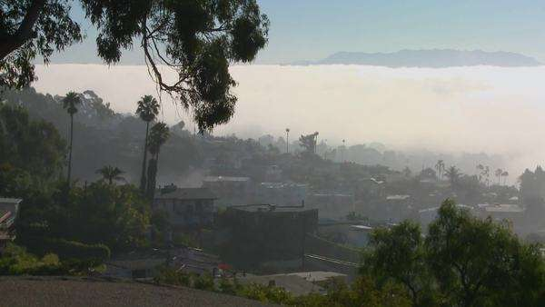 Fog rolls into neighbors in Southern California in this timelapse shot. Royalty-free stock video