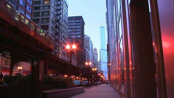 The El train passes on an elevated platform at dusk in downtown Chicago. Royalty-free stock video