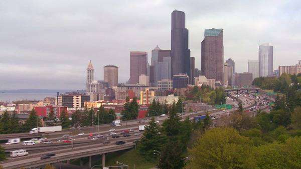 Traffic moves along a busy freeway into Seattle Washington. Royalty-free stock video