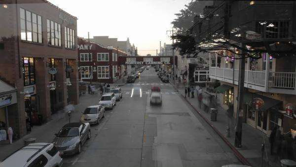 Evening timelapse of tourists shopping on historic Cannery Row in Monterey, California. Royalty-free stock video