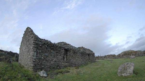 Panning timelapse of clouds blowing over the ruins in Glencolumbkille, County Donegal, Ireland. Royalty-free stock video