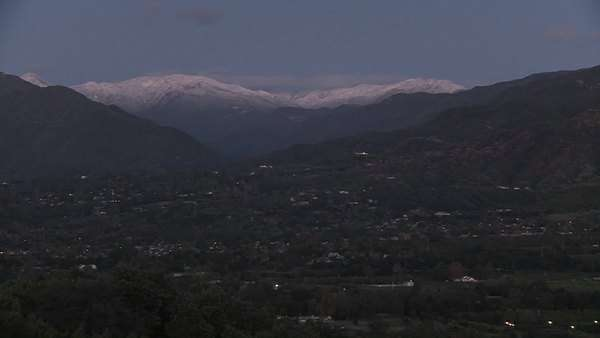 Timelapse of sunrise after a snowstorm above Ojai, California. Royalty-free stock video