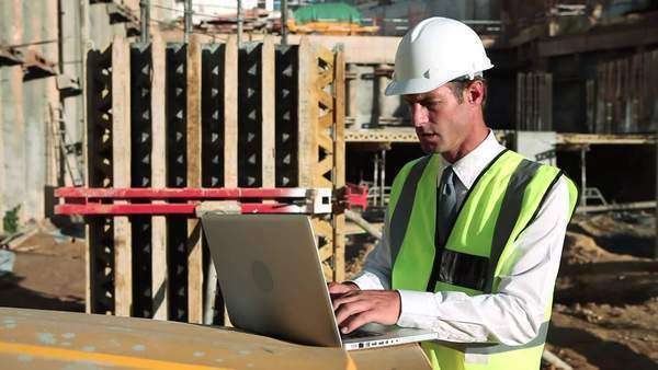Mature man using laptop on construction site Royalty-free stock video