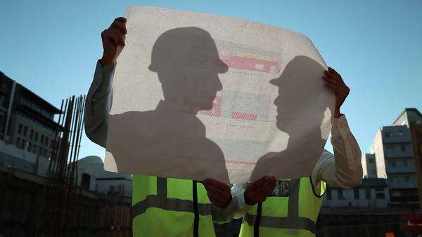 Mature men inspecting blueprints on construction site Royalty-free stock video
