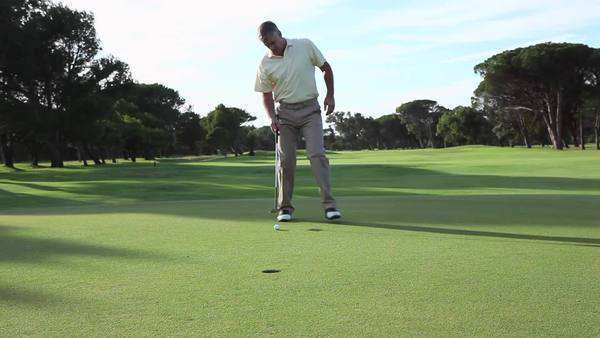 Mature man playing golf on golf course Royalty-free stock video