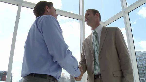 Two businessmen meeting in office, shaking hands Royalty-free stock video