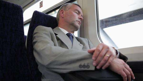 Businessman sleeping on commuter train Royalty-free stock video