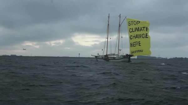A ship with a flag proclaims an end to global warming. Royalty-free stock video