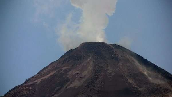 An active volcano bilious smoke and ash. Royalty-free stock video