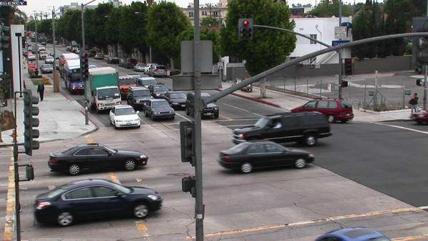 Traffic drives through a intersection. Royalty-free stock video