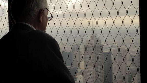 Senior man looks out window of an observatory Royalty-free stock video