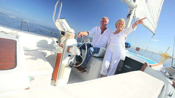 Healthy retired couple enjoying life aboard their luxury sailing yacht Royalty-free stock video