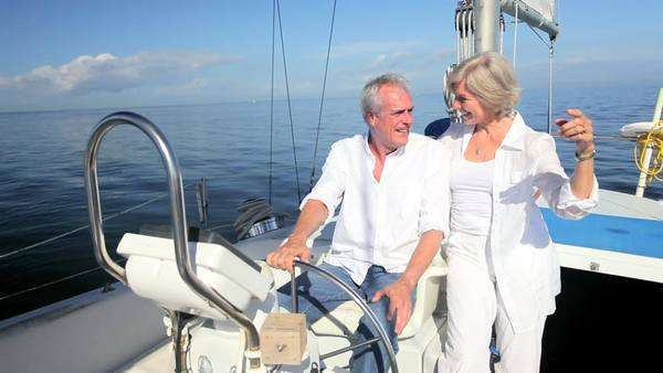 Healthy retired couple enjoying their leisure aboard their luxury sailing boat Royalty-free stock video