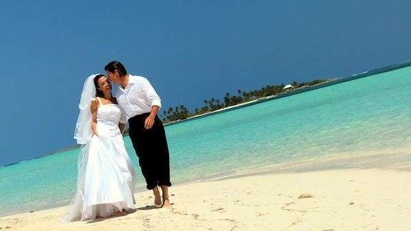 wedding,bride,bridegroom,Caucasian,heterosexual,couple,romance,marriage,luxury,dress,veil,suit,barefoot,casual,dream,celebration,honeymoon,imagination,fashion,commitment,teamwork,love,dreams,travel,destination,ocean,remote,island,paradise,tropical,caribbean,lifestyle Royalty-free stock video