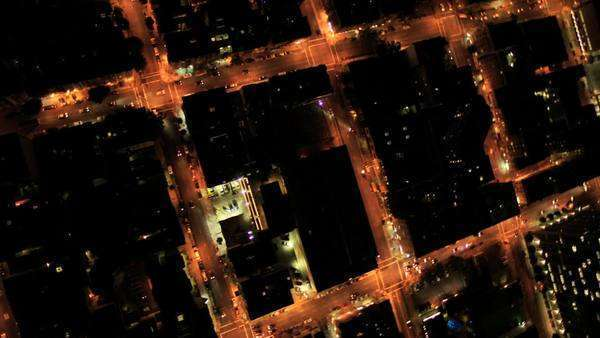 Aerial night vertical view of rolling road grid system in modern developing city, America Royalty-free stock video