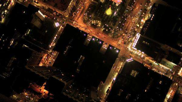 Aerial night illuminated vertical view of city skyscrapers and cars in the streets of San Francisco, North America, Royalty-free stock video