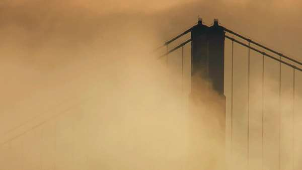 Timelapse clouds fog swirling close up tower Golden Gate Bridge Royalty-free stock video