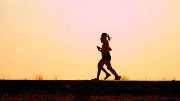 Healthy females runner work out on road sunrise shot on RED EPIC Royalty-free stock video