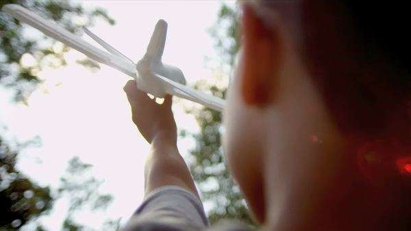 Young ethnic boy with a toy airplane acting out his childhood dreams shot on RED EPIC Royalty-free stock video