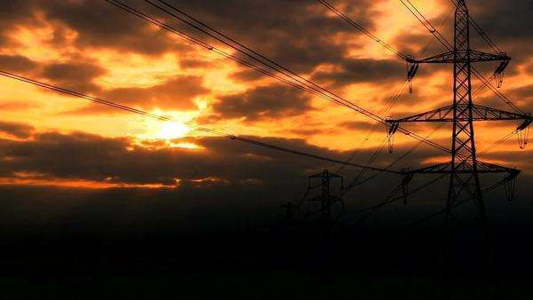 Timelapse clouds at sunset over electricity pylons Royalty-free stock video