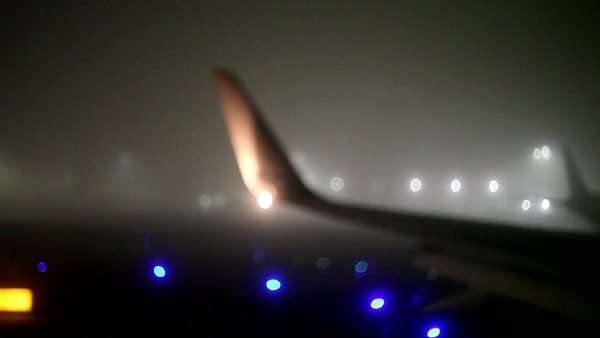 Soft focus of tail of airplane as it taxies on runway Royalty-free stock video