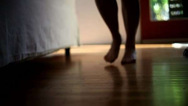 Woman's bare feet skipping across hardwood floor in bedroom Royalty-free stock video